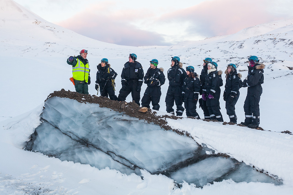 UNIS professor Doug Benn lectures his students about glaciers from the foot of Tellbreen, Svalbard.