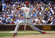 CHICAGO - AUGUST 13:  Cliff Lee #34 of the Philadelphia Phillies pitches against the Chicago Cubs on August 13, 2009 at Wrigley Field in Chicago, Illinois.  The Phillies defeated the Cubs 6-1.  (Photo by Ron Vesely)