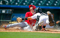 Hammerheads BJ Lopez tags out Cardinals Nick Dunn during a game on April 7,2019.<br /> <br /> Photo by Tom DiPace