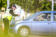 An NHS (National Health Service) worker or care worker is seen consulting whilst proceeding with tests at o2 testing Centre for COVID-19 at a drive-through testing centre in a car park at O2 Testing centre in Greenwich, London, Monday, May 4, 2020. <br /> The UK continues in lockdown to help curb the spread of the coronavirus, which has impacted on nations around the globe imposing self-isolation and exercising social distancing when people move from their homes. (Photo/ Vudi Xhymshiti)