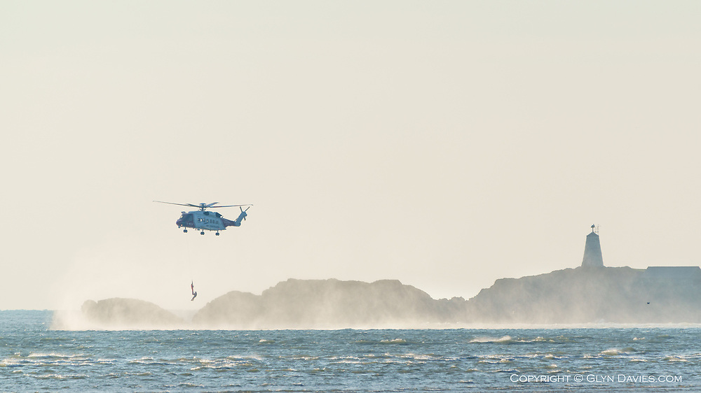The UK Coastguard Sikorsky S-92 helicopter from Caernarfon Airport, in rescue training off Llanddwyn Island. The air was around 1º before wind chill, so I can only imagine how much hot tea he drank after this half hour session of being dunked in the brine!