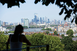 ©Licensed to London News Pictures 31/07/2020     Greenwich, UK. A view of London from Greenwich park, Greenwich. Today is set to be the hottest day of the year so far with temperatures to hit 35C in parts of the UK. Photo credit: Grant Falvey/LNP