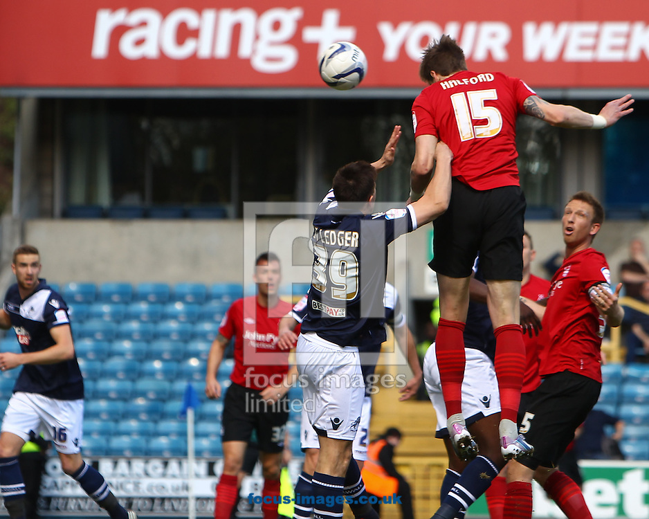 Picture by John Rainford/Focus Images Ltd +44 7506 538356.27/04/2013.Sean St Ledger of Millwall fails to stop Greg Halford of Nottingham Forest opening the scoring during the npower Championship match at The Den, London.