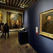 """VENICE, ITALY - NOVEMBER 23:  Two women walk next to two paintings, on the foreground """"Ritratto di Gentiluomo"""" by Lorenzo Lotto at the press preview of Tribute to Lorenzo Lotto - The Hermitage Paintings at Accademia Gallery on November 23, 2011 in Venice, Italy. The exhibition which includes two very rare & never seen before paintings opens from the 24th November 2011 to 26th February 2012 in Italy."""