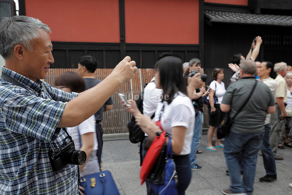 tourist taking a picture in Kyoto Japan