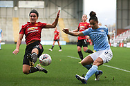 Manchester United forward Jess Sigsworth (9) blocks the cross from Manchester City defender Demi Stokes (3) during the FA Women's Super League match between Manchester United Women and Manchester City Women at Leigh Sports Village, Leigh, United Kingdom on 14 November 2020.