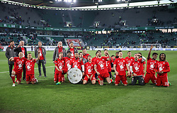 WOLFSBURG, April 30, 2017  Bayern's head coach Carlo Ancelotti(2nd L) and the players celebrate winning the title after the German Bundesliga match between VfL Wolfsburg and Bayern Munich in Wolfsburg, Germany, on April 29, 2017. Bayern Munich won 6-0 to clinch its fifth consecutive Bundeslisga title ahead of schedule at the 31st round on Saturday. (Credit Image: © Shan Yuqi/Xinhua via ZUMA Wire)