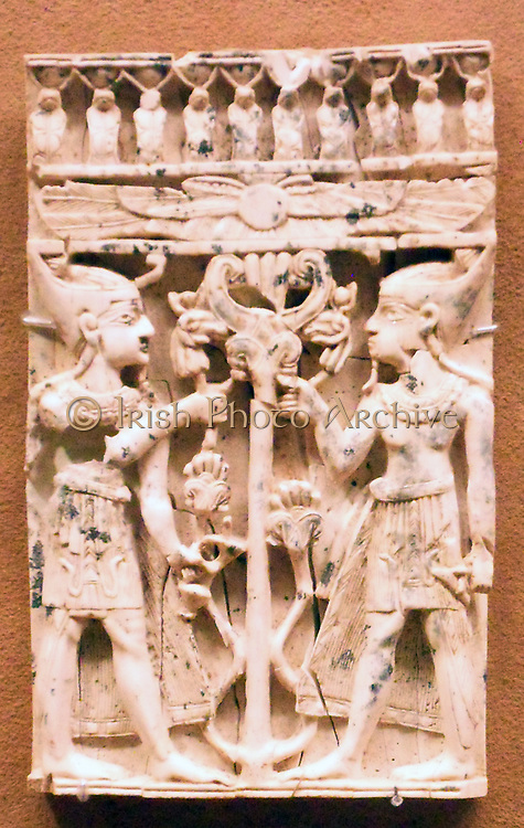 Ivory plaque with pharaonic figures flanking a sacred tree Art. Neo-Assyrian, ca. 9th–8th century B.C. Excavated by Sir Max Mallowan