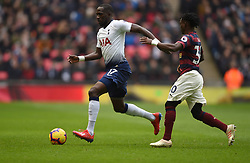 Tottenham Hotspur's Moussa Sissoko (left) and Newcastle United's Christian Atsu battle for the ball