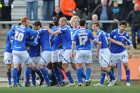 Portsmouth's Jed Wallace celebrates scoring his sides second goal with team mates<br /> <br /> Photo by Ashley Crowden/CameraSport<br /> <br /> Football - The Football League Sky Bet League Two - Newport County AFC v Portsmouth - Saturday 29th March 2014 - Rodney Parade - Newport<br /> <br /> © CameraSport - 43 Linden Ave. Countesthorpe. Leicester. England. LE8 5PG - Tel: +44 (0) 116 277 4147 - admin@camerasport.com - www.camerasport.com