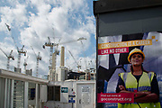 A poster encouraging women to choose a career in the construction industry hangs on a wall as work continues on Battersea Power Station in London, United Kingdom on 6th August 2019. Battersea Power Station is a decommissioned coal-fired power station on the south side of the River Thames.The site is being redeveloped into residential units, bars, restaurants, office space, shops and entertainment spaces.