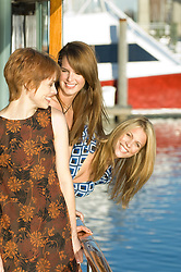 Three women at a marina