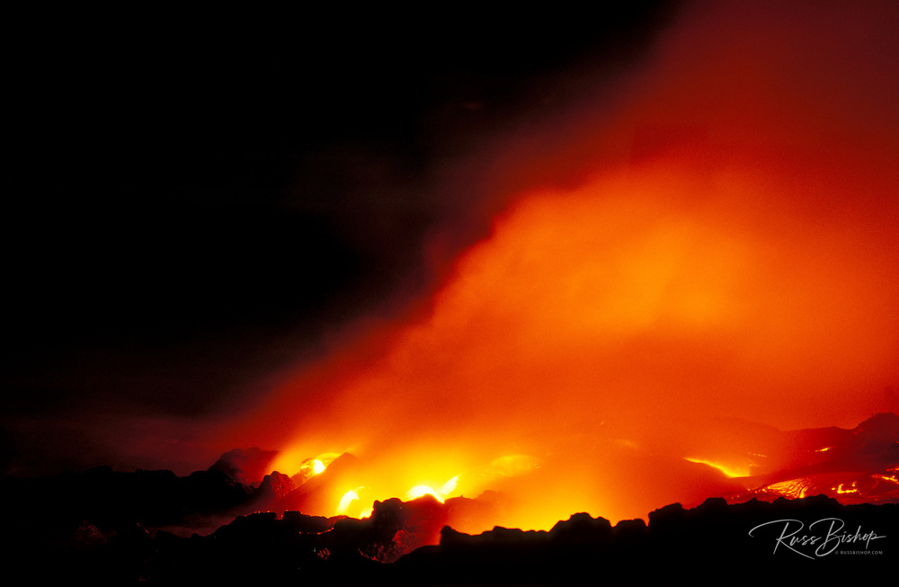 Lava flow entering the Pacific Ocean at night, Hawaii Volcanoes National Park, The Big Island, Hawaii USA