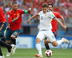 MOSCOW, July 1, 2018  Sergio Ramos (L) of Spain vies with Roman Zobnin of Russia during the 2018 FIFA World Cup round of 16 match between Spain and Russia in Moscow, Russia, July 1, 2018. (Credit Image: © Wu Zhuang/Xinhua via ZUMA Wire)