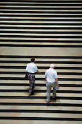 Elderly couple walking up steps