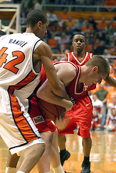 02 January 2004  Randle reached in on Gregg Alexander attempting to jostle the bal loose. Illinois State University ties up The Fightin Illini in regulation but fails to top the Big 10 team in overtime. Action took place at the Assembly Hall on the University of Illinois Campus in Champaign - Urbana Illinois.