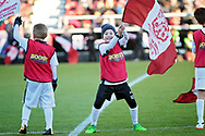 An excited mascot waving a Northampton Town flag before the EFL Sky Bet League 1 match between Northampton Town and Bury at Sixfields Stadium, Northampton, England on 25 November 2017. Photo by Nigel Cole.