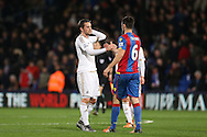 Gylfi Sigurdsson of Swansea City and Scott Dann of Crystal Palace shake hands after full time. Barclays Premier League match, Crystal Palace v Swansea city at Selhurst Park in London on Monday 28th December 2015.<br /> pic by John Patrick Fletcher, Andrew Orchard sports photography.