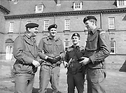1983-04-12.12th April 1983..Photographed at McKee Barracks, Cork..At Ease..From left to right:..Lieutenant Commandant Patsy McHale..Lieutenant Eugene Doyle of Cork..Sergeant Kevin O'Donovan, Riverstick, Cork..Lieutenant Martin Murphy of Cork