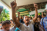 """01 FEBRUARY 2014 - BANGKOK, THAILAND: Thai voters try to get into the district office in Din Daeng in Bangkok so they could vote. They were not able to vote because protestors blocked the polls. Thais went to the polls in a """"snap election"""" Sunday called in December after Prime Minister Yingluck Shinawatra dissolved the parliament in the face of large anti-government protests in Bangkok. The anti-government opposition, led by the People's Democratic Reform Committee (PDRC), called for a boycott of the election and threatened to disrupt voting. Many polling places in Bangkok were closed by protestors who blocked access to the polls or distribution of ballots. The result of the election are likely to be contested in the Thai Constitutional Court and may be invalidated because there won't be quorum in the Thai parliament.    PHOTO BY JACK KURTZ"""