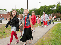 First graders Emma Welch and Kali Muzzey begin their walk Thursday morning from Elm Street School to Leavitt Park as part of the WALK NH program.   (Karen Bobotas/for the Laconia Daily Sun)
