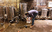 Lou Lenz, brewmaster and owner of the Kaskaskia Brewing Company in Red Bud, adjusts a pump line in the basement of the building, where he brews a variety of beers.
