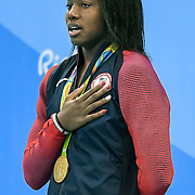 United States swimmer Simone Manuel cried during the National Anthem after tying for a gold medal in the women's 100m freestyle with Canada's Penny Oleksiak, right, on Thursday at the Olympic Aquatics Stadium during the 2016 Summer Olympics Games in Rio de Janeiro, Brazil.