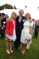 ARNAUD BAMBERGER MD of Cartier and his wife CARLA and their daughter AMELIA at the Cartier International polo at Guards Polo Club, Windsor Great Park on 29th July 2007.<br />