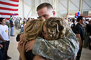 "30 MARCH 2008 -- PHOENIX, AZ: Arizona National Guard soldiers greet their loved ones after they returned to Phoenix, AZ, Sunday from a year long deployment to Afghanistan. About 250 members of the Arizona Army National Guard's 158th Infantry Battalion returned to Phoenix, AZ, from a year long deployment in Afghanistan Sunday. The unit, also known as the ""Bushmasters"" from their service in World War II, was part of the largest single-unit deployment of the Arizona National Guard since the second World War. Two members of the battalion were killed in action during their deployment. The battalion, a combat unit, engaged in counter insurgency operations through out their deployment. Photo by Jack Kurtz / ZUMA Press"