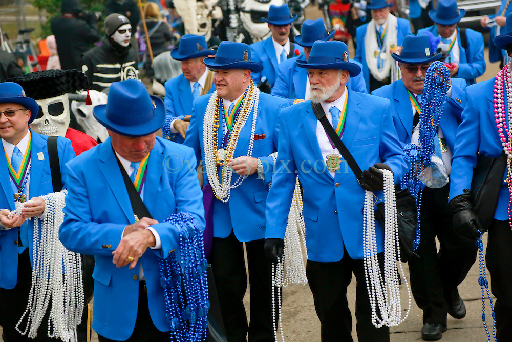 17 Feb 2015. New Orleans, Louisiana.<br /> Early morning Mardi Gras Day. Pete Fountain's Half fast Walking Club parade along St Charles Avenue before the major parades start to roll.<br /> Photo; Charlie Varley/varleypix.com