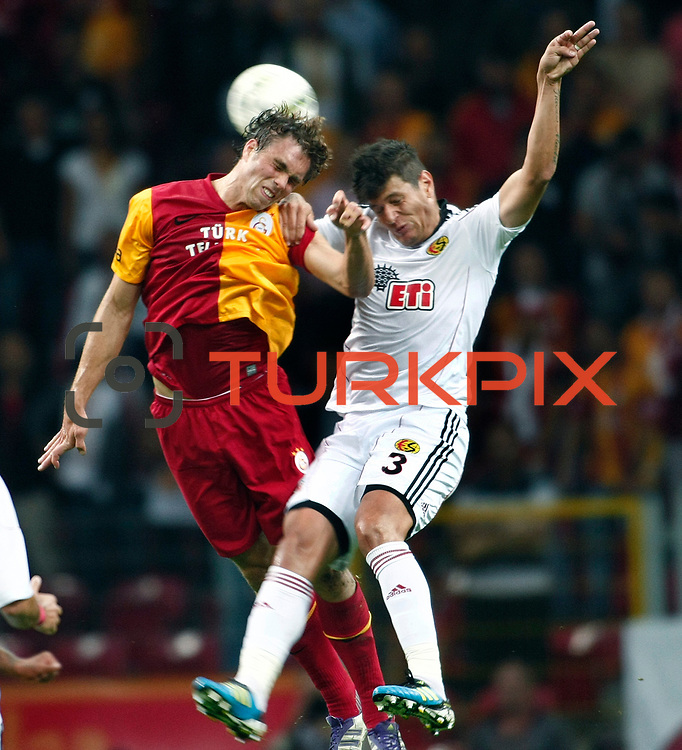Galatasaray's Johan ELMANDER (L) and Eskisehirspor's Diego Angelo De OLIVERA (R) during their Turkish Super League soccer match Galatasaray between Eskisehirspor at the TT Arena at Seyrantepe in Istanbul Turkey on Monday, 26 September 2011. Photo by TURKPIX