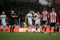 Middlesbrough's Patrick Bamford is held back following a foul by Brentford's Romaine Sawyers, for which Sawyers was then given a second yellow card