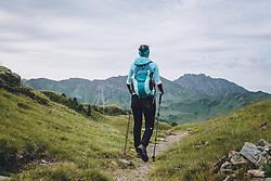 THEMENBILD - eine Wanderin mit Rucksack und Wanderstöcken geht auf einem schmalen Wanderweg, aufgenommen am 13. August 2020, Saalbach Hinterglemm, Österreich // a female hiker with rucksack and walking sticks walks on a narrow hiking trail on 2020/08/13, Saalbach Hinterglemm, Austria. EXPA Pictures © 2020, PhotoCredit: EXPA/ Stefanie Oberhauser