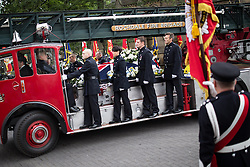 © Licensed to London News Pictures . 02/09/2013 . Bury , UK . Stephen Hunt's coffin is delivered to the church aboard a vintage fire truck . The funeral of fireman Stephen Hunt at Bury Parish Church today (Tuesday 3rd September 2013) . Stephen Hunt died whilst tackling a blaze at Paul's Hair World in Manchester City Centre in July 2013 . Photo credit : Joel Goodman/LNP