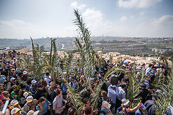 14 April 2019, Jerusalem: On Palm Sunday, thousands gathered and marched from the Mount of Olives down to the Old City of Jerusalem, following in the footsteps of Jesus, as he journeyed to Jerusalem.