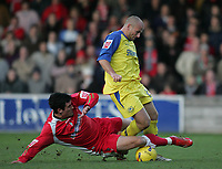 Photo: Lee Earle.<br /> Torquay United v Swindon Town. Coca Cola League 2. 18/11/2006. Swindon's Lee Peacock (L) brings down Adam Murray.
