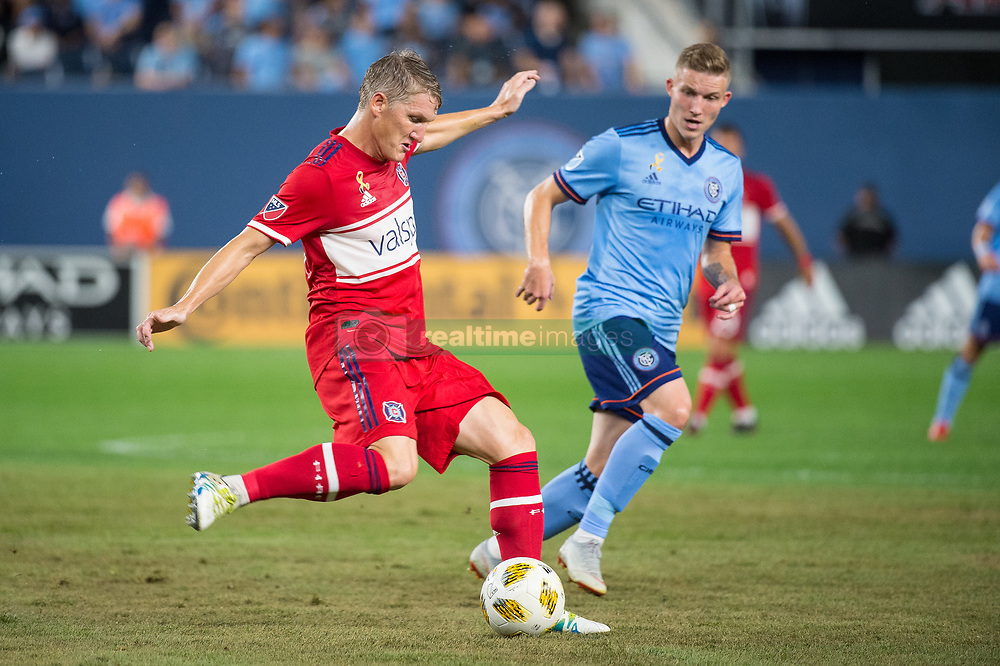 September 26, 2018 - Bronx, New York, US - Chicago Fire midfielder BASTIAN SCHWEINSTEIGER (31) clears the ball while New York City FC midfielder ALEXANDER RING (8) looks on during a regular season match at Yankee Stadium in Bronx, New York.  New York City FC defeats Chicago Fire 2 to 0 (Credit Image: © Mark Smith/ZUMA Wire)