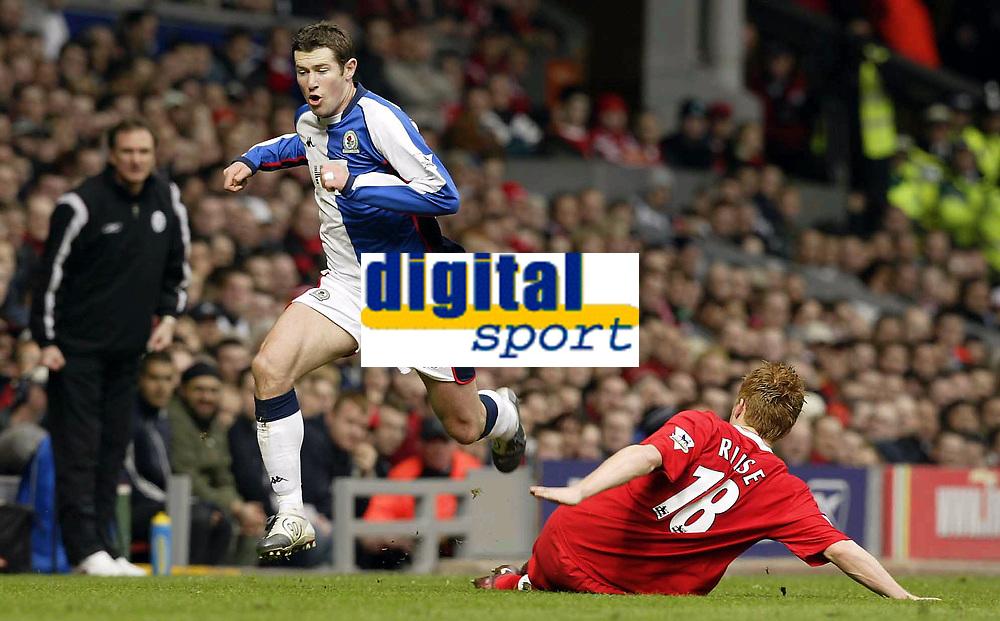 Photo. Aidan Ellis.<br /> Liverpool v Blackburn.<br /> FA Barclaycard Premiership.<br /> 04/04/2004.<br /> Liverpool's John Arne Riise stops the run of Blackburn's Brett Emerton