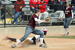 06 April 2013:  Jhavon Hamilton gets tagged out at third by  Heather Duckworth during an NCAA Division 1 Missouri Valley Conference (MVC) women's softball game between the Drake Bulldogs and the Illinois State Redbirds on Marian Kneer Field in Normal IL