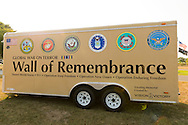 """East Meadow, New York, U.S. 11th September 2013. The Wall of Remembrance trailer is by the Global War on Terror """"Wall of Remembrance"""" a traveling memorial on display in New York for the first time, at Eisenhower Park on the 12th Anniversary of the terrorist attacks of 9/11. The unique 94 feet long by 6 feet high wall has, on one side, almost 11,000 names of those lost on September 11, 2001, along with heroes and veterans who lost their lives defending freedom of Americans over past 30 years. On the wall's other side is a timeline, with photos, covering 1983 to present day."""