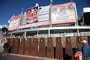 Fans check out a player display in front of the exterior of Sports Authority Field at Mile High before the Denver Broncos NFL football AFC Championship Game against the New England Patriots on Sunday, Jan. 19, 2014 in Denver. The Broncos won the game 26-16. ©Paul Anthony Spinelli