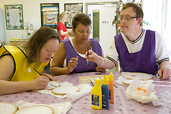 Day Service Care Assistant supervising service users with learning disabilities,