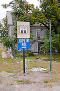 A Route 66 sign in Kansas points the way to Joplin, Missouri. Missoula Photographer