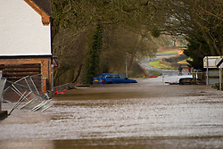 © Licensed to London News Pictures. 18/02/2020. Upton-upon-Severn, Worcestershire, UK. A car gets caught in the flooding at Upton-upon-Severn in Worcestershire, UK. Though river levels have dropped fractionally, a severe flood warning is still in force at Upton-upon-Severn, in Worcestershire, UK. Photo credit: Graham M. Lawrence/LNP