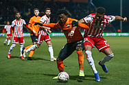 Barnet midfielder Ephron Mason-Clark (27) and Brentford defender Julian Jeanvier (23) battle for possession during The FA Cup fourth round match between Barnet and Brentford at The Hive Stadium, London, England on 28 January 2019.