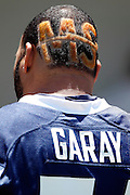 San Diego Chargers defensive tackle Antonio Garay (71) sports the letters MS cut and colored in his hair on the back of his head as he talks to the media after the NFL football minicamp on Tuesday, June 19, 2012 in San Diego, California. ©Paul Anthony Spinelli