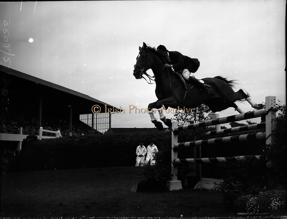 """03/08/1960<br /> 08/03/1960<br /> 03 August 1960<br /> R.D.S Horse Show Dublin (Wednesday). David Broome of Great Britain clearing a pole jump on """"Sunsalve"""" at the Dublin Horse Show."""