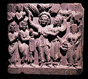 Birth of the Budha.  Gandhara, about AD 200.  Schist.  Standing in a grove, Queen Maya gave birth to Prince Siddhartha Gautama, the future Buddha, from her right side.  The infant is receved by the god Indra, whilst other deities stand in attendance.