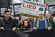 Stella Moris c, flanked by Richard Burgon MP l and Kristinn Hrafnsson r, takes part in the March for Assange from BBC Broadcasting House to the Royal Courts of Justice organised by the Dont Extradite Assange campaign on 23rd October 2021 in London, United Kingdom. The US government will begin a High Court appeal on 27th October against a decision earlier this year not to extradite Wikileaks founder Julian Assange to face espionage charges in the United States. Assange has been held in Belmarsh Prison since 2019.
