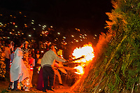 Lighting of a large bonfire, or Demera during the celebration of Meskel (an annual religious holiday of the Ethiopian Orthodox Church which commemorates the discovery of the True Cross by the Roman Empress Helena in the fourth century. Arba Minch, Ethiopia.